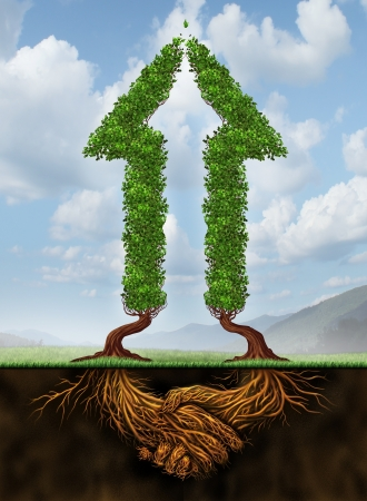 Collaborating for growth as a business agreement and cooperation concept in financial success between a group of partners working together as a concept of two arrow shaped trees with roots in the form of a hand shake