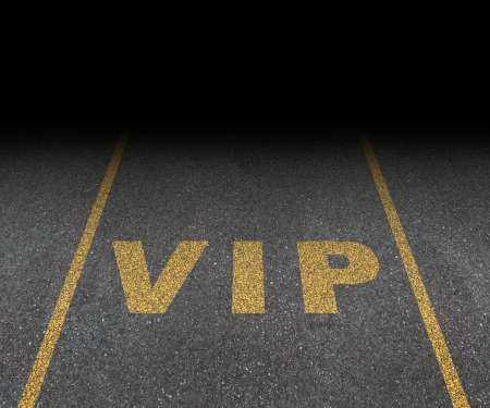 VIP service symbol with a first class reserved parking space for with a sign painted on asphalt as a symbol of exclusive hospitality with the royal treatment with a blank area for text
