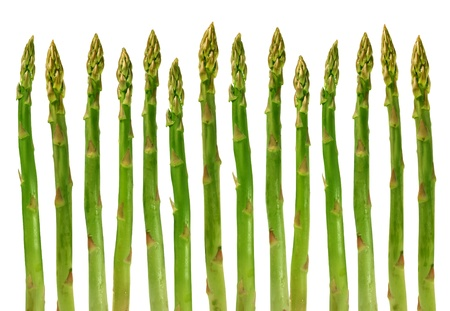 Asparagus group of green healthy vegetables organized in a row isolated on a white background as a food concept of health diet and living a natural fit well nourished life