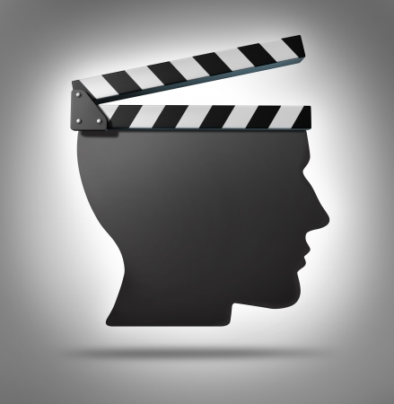 Life direction and human guidance as a symbol of a movie equipment clapboard shaped as a head ins a concept for living and taking action in your biography