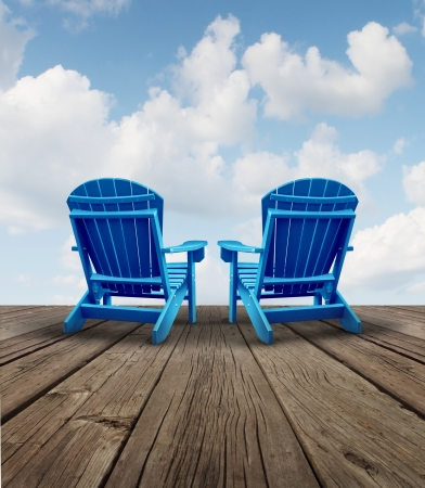 Retirement relaxation and financial planning symbol with two empty blue adirondack chairs on a wood patio deck with a sky view as a business freedom concept of future successful investment strategy