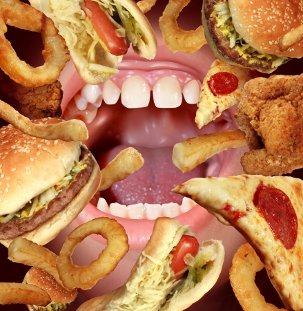 Unhealthy Eating and struggling to follow a healthy diet health concept by the temptations of fried fast food as a hamburger hot dog french fries onion rings pizza with an opened hungry mouth