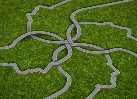 Common strategy business concept with a group of roads and highways in the shape of a human head comming together and merging into a connected network of success on a grass background