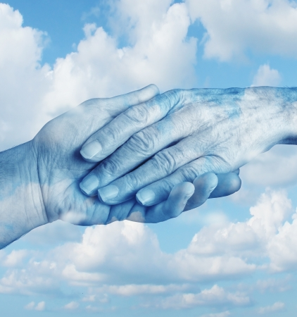 Say goodbye mourning and grief concept with the hand of a young person letting go an elderly senior who is in the final stages of life on a sky background as a symbol of heaven and emotional feelings related to terminal patients    sa