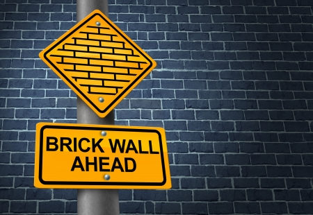 Against A Brick Wall business concept of hardship and difficult restrictions faced on a journey