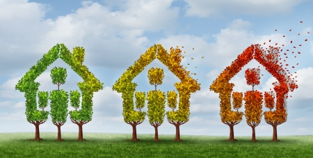 Housing market change and real estate industry changing conditions as a concept with a group of trees with leaves turning from green to autumn yellow and red losing foliage with the fall winds as a metaphor for home prices and mortgage rates uncertainty