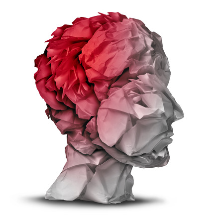 Head injury and traumatic brain accident medical  and mental health care concept with a group of crumpled office paper shaped as a human mind with red highlighted area as a symbol of trauma problem