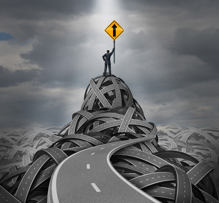 Direction leadership concept as a businessman standing on a mountain peak of tangled roads holding up a traffic sign with an upward arrow as a success metaphor and symbol for financial guidance and clear vision from a confident skilled manager
