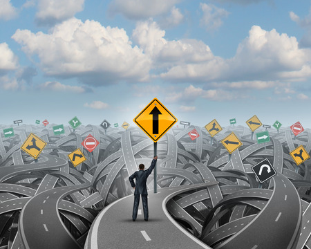 Success direction with a confident businessman standing on a group of tangled streets holding up a traffic sign with an upward arrow as a symbol for clear belief and conviction to a path of prosperity overcoming confusion and fear
