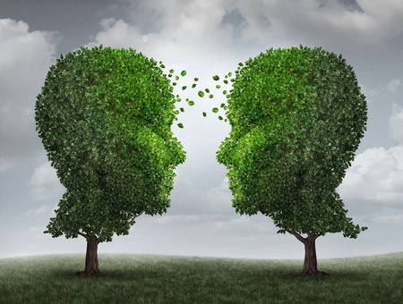Communication and growth concept as a growing partnership and teamwork exchange in business with two trees in the shape of human heads on a sky with leaves exchanging from one face to the other as a concept of cooperation.