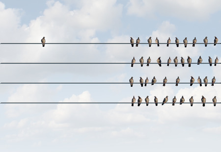 Individuality symbol and independent thinker concept and new leadership concept or individuality as a group of pigeon birds on a wire with one individual bird in the opposite direction as a business icon for new innovative thinking.