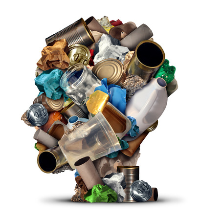 Recycling ideas and environmental garbage management solutions and creative ways to reuse waste as old paper glass metal and plastic bottles shaped as a human head as a symbol for reusable thinking and conservation advice.