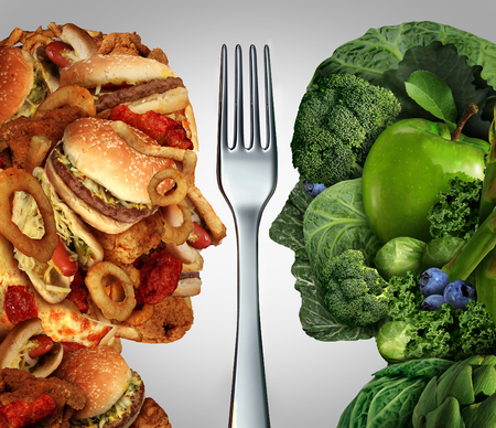 Nutrition decision concept and diet choices dilemma between healthy good fresh fruit and vegetables or greasy cholesterol rich fast food shaped as a human head divided by a fork as a symbol for trying to decide what to eat.
