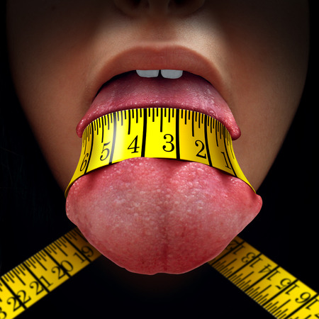 Calorie restriction concept as a tape measure wrapped tight around a human tongue as a fasting diet or dieting symbol for anorexia or dietary control.
