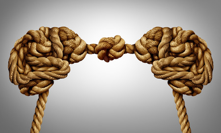 United thinking concept as an alliance for ideas exchange and common agreement as two brains made of rope tied together as a symbol for cooperation.