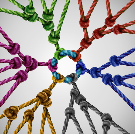 Team groups network as individual diverse teams coming together connected to a central point as an abstract communication concept with linked ropes of different colors as a metaphore for social connection.