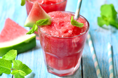 Photo for Watermelon smoothie in a glass on a blue wooden table. - Royalty Free Image