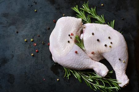 Foto für Raw chicken legs on a black background. - Lizenzfreies Bild