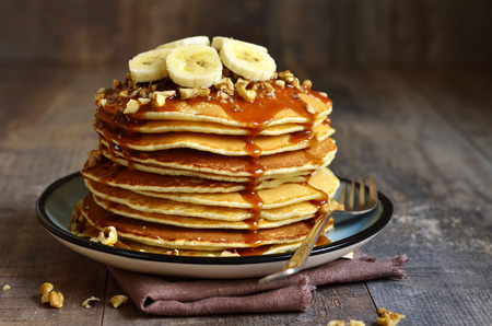 Photo for Pancakes with banana,walnut and caramel for a breakfast. - Royalty Free Image