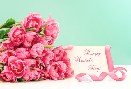 Pink tulips and greeting card with sample text Happy Mother