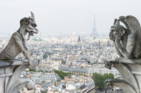 Foto de Stone demons gargoyle und chimera with Paris city on background  View from Notre Dame de Paris - Imagen libre de derechos