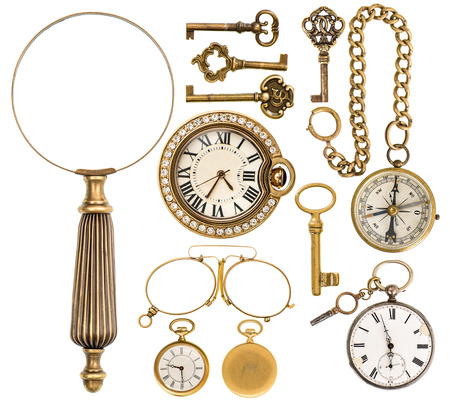 collection of golden vintage accessories, jewelry and objects. antique keys, clock, loupe, compass, glasses isolated on white background
