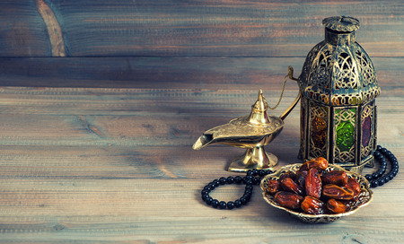 Dates, arabian lantern and rosary. Islamic holidays concept. Ramadan decoration. Retro style toned picture