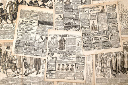 Newspaper pages with antique advertising. Woman