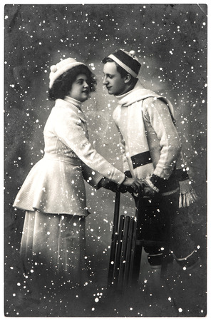 happy young couple outdoors. winter holidays. vintage picture with original film grain and blur