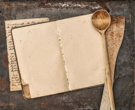 Foto de Vintage handwritten recipe book and old kitchen utensils on rustic metal background. Retro style toned picture - Imagen libre de derechos