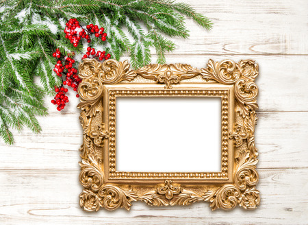 Christmas decoration with golden picture frame on wooden background. Winter holidaysの写真素材