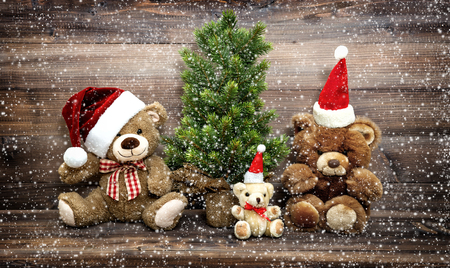 Photo pour Christmas decoration with funny toys Teddy Bear family. Vintage style toned picture with falling snow effect - image libre de droit