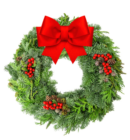 Christmas wreath from spruce, pine and fir twigs with red ribbon bow isolated on white background