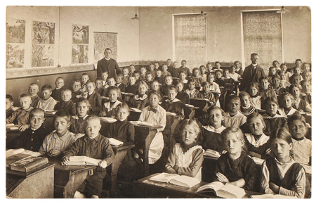 Photo for Retro picture of classmates. Group of children in the classroom. Vintage photo from about 1936 with original film-grain, blur, scratches - Royalty Free Image