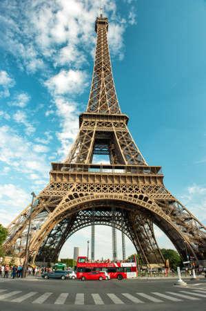Photo pour Eiffel Tower (La Tour Eiffel) in Paris over cloudy blue sky - image libre de droit
