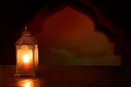 Photo pour Islamic Greeting Cards for Muslim Holidays. Ramadan Kareem background.Eid Mubarak, greeting background  with  ñolorful  lantern on wooden  table - image libre de droit