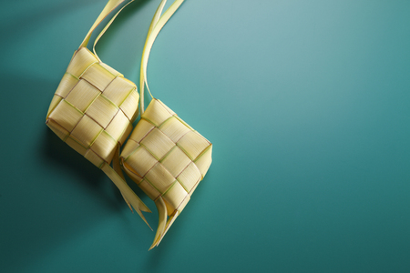 Photo for two ketupat with green background - Royalty Free Image
