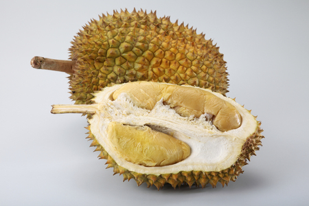 Photo for durian and a half on the plain background - Royalty Free Image