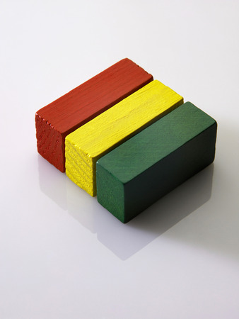 Three building blocks arranged together.