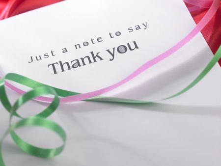 Foto de Thank you card with the ribbon - Imagen libre de derechos