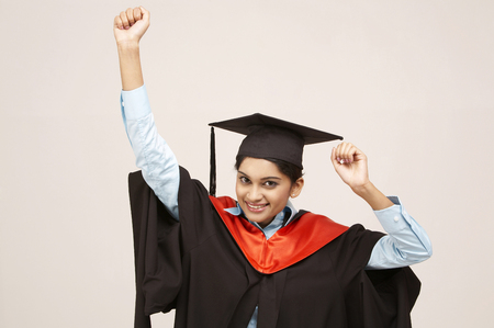 Photo for young graduate with arms raised - Royalty Free Image