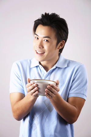 Photo for man with casual wearing holding a bowl - Royalty Free Image