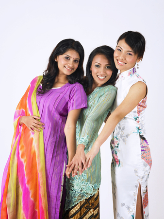 Foto de malay,chinese and indian girls put hands together - Imagen libre de derechos
