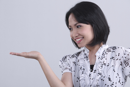 Photo for Side view of young woman with hand gesture - Royalty Free Image