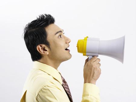 profile of man with loudspeaker