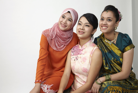 Photo pour three malaysian sitting together with same vision - image libre de droit