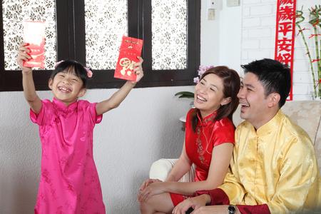 Photo for chinese family enjoying chinese new year - Royalty Free Image