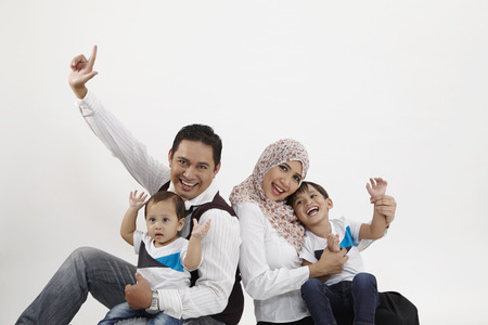 Foto de family of four on the white background - Imagen libre de derechos