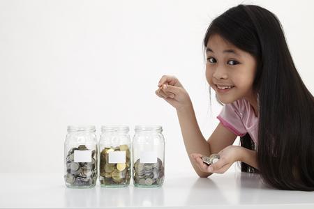 Photo pour little with three saving jars - image libre de droit