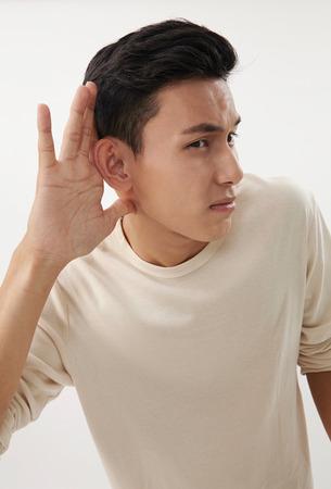 Photo pour malay man concentration to listen - image libre de droit